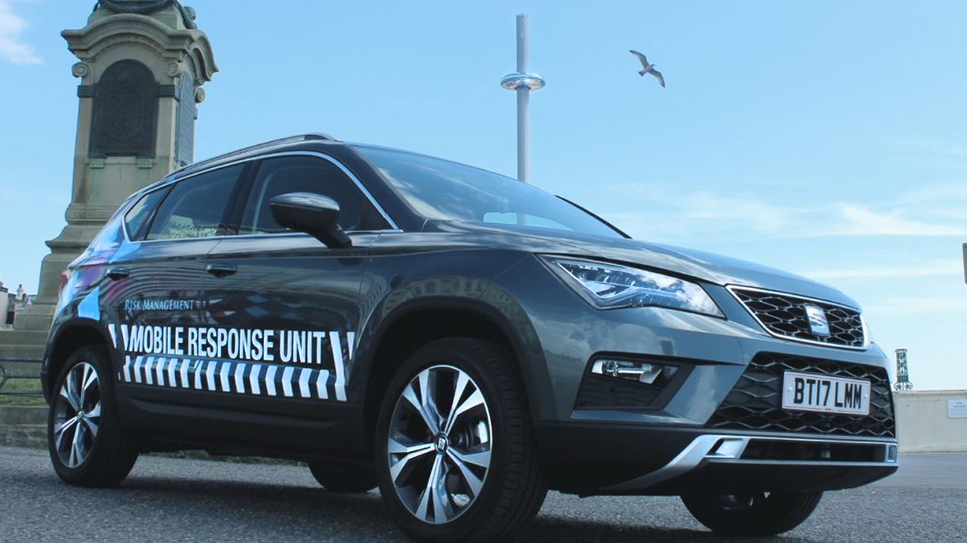 Consec Risk Management mobile support unit car Seat Ateca on Brighton beach with the i360 in the distance