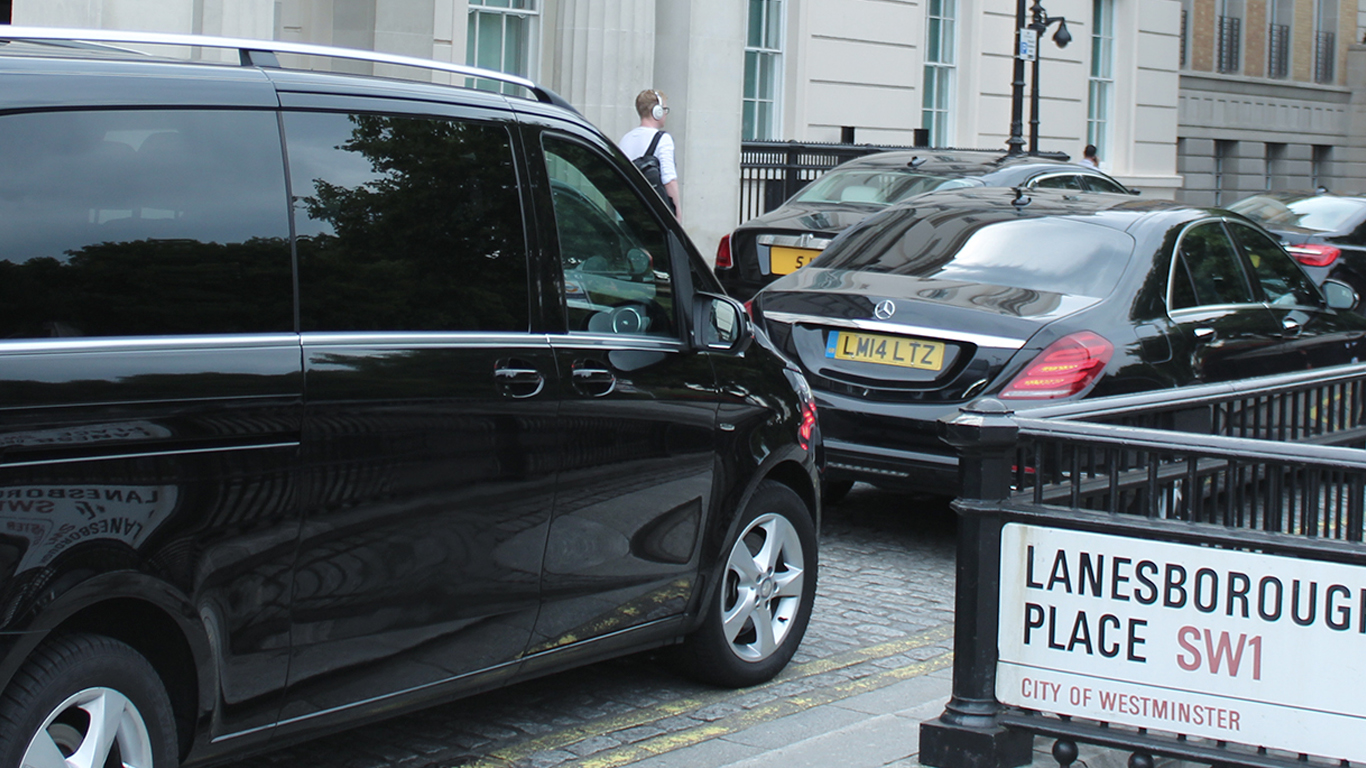 Chauffeur vehicle convoy outside Lanesborough hotel in London